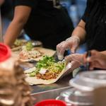 Chipotle executives predict rough earnings year; say outbreak won't recur