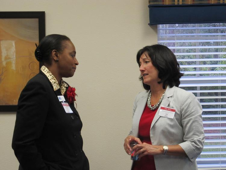 Alice Delgardo, manager, community outreach, United Way of Pasco, with Jodi Perez, co-president, Independent Financial Services.