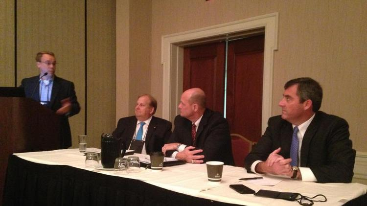 Tom Sims, vice president of brokerage and industrial services, led a panel Wednesday morning at the Seelbach Hilton Hotel on the industrial real estate market. Serving on the panel were, from left, Kevin Grove of CBRE Inc. of Louisville, Steve Gray of Commercial Kentucky Inc. and Powell Spears of Harry K. Moore Co.