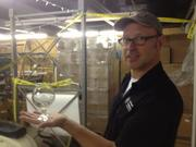 Scott Smith shows off some of the brewery's new glassware.