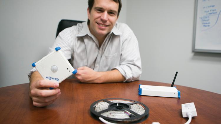Ed Hemphill of WigWag shows off a sensor that can control household devices such as lamps and sprinkler systems. It's a crowded market, but he says his products have an edge.