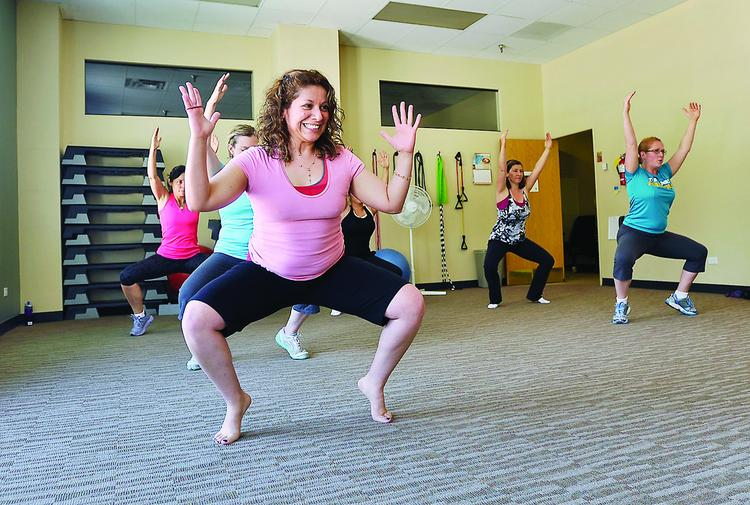 Carmen Guevara, post-closing analyst at CHFA, participates in a Zumba class the company offers employees on site.