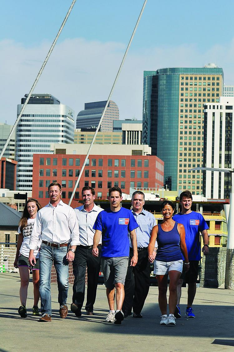 The Beck Group employees walk over Millenium Bridge. The company conducted a 90-day Walk to Wellness program.