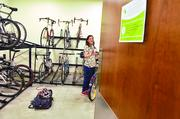 Jessica Crow, IT manager at DaVita, parks her bike after riding to work on Bike to Work Day.