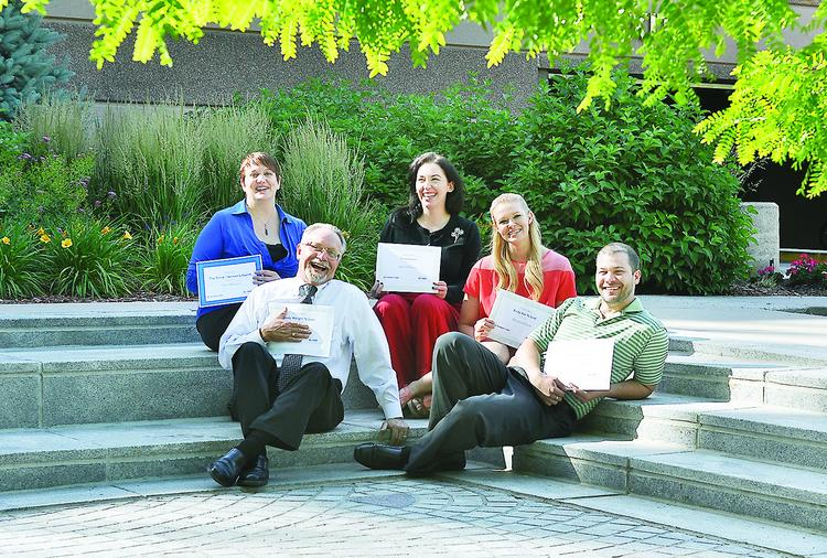 From left, Transwestern Transform 3.0 award winners Terri Redman, property assistant; Bruce Harley, director of operations; Wendi Malone, assistant property manager; Christina Blank, receptionist; and Brian Wingate, broker. The awards are similar to the Biggest Loser competition for weight loss, body fat percentage and lost inches.