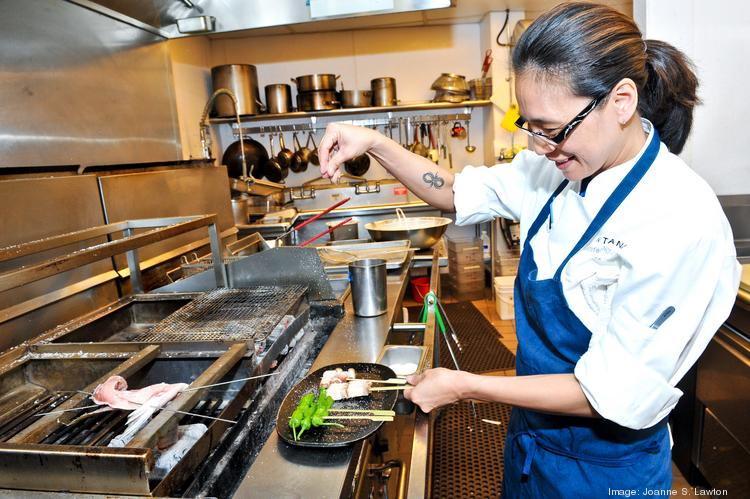 Executive Chef Jennifer Nguyen with her custom-made robata grill at Zentan at the Donovan House hotel.