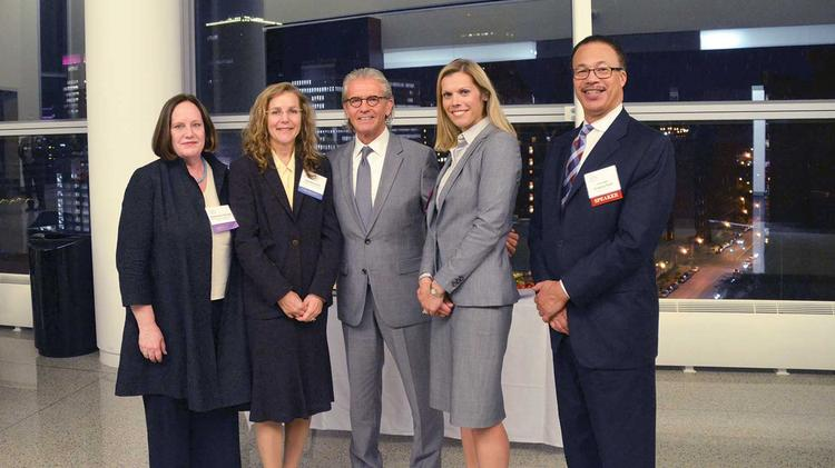 Chief Judge William Skretny, center, with Annemarie Hasset, left, executive director of NYU Law School's Engelberg Center of Law and Technology; Dorothy Auth, partner at Cadwalader Wickersham and Taft; Jessica Copeland of Hodgson Russ; and Judge Gregory Sleet of the District of Delaware.