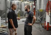 Surly Brewing CEO Omar Ansari (left) talks with brewer Mike Willaford.