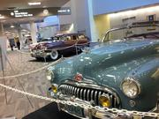 A collection of classic cars at the show includes a 1948 Buick Super convertible.