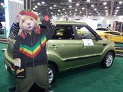 The 2013 Kia Soul, with a cutout of the hamster character from its TV ads.