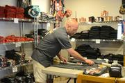 Beer isn't Surly Brewing's only business. John Culbertson folds t-shirts in the merchandise shop.