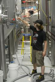 Surly brewery worker Paul Stelmach. The brewery is nearing round-the-clock production, with the last worker out the door at 1 a.m. and the first worker starting the next day three hours later.