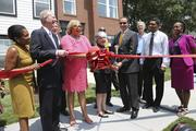 Cutting the ribbon on the new model home at MetroTowns Parkside on July 18 were D.C. Councilmember Jack Evans; United Bank Regional President Thomas Nida; D.C. Councilmember Yvette Alexander; Enterprise Homes Inc. President and CEO Chickie Grayson; D.C. Mayor Vincent Gray; Robert Pollin, son of the late Abe Pollin, who envisioned MetroTowns; and Enterprise Homes Senior Development Director Corey Powell cut the ribbon on the new model home at MetroTowns Parkside on July 18.