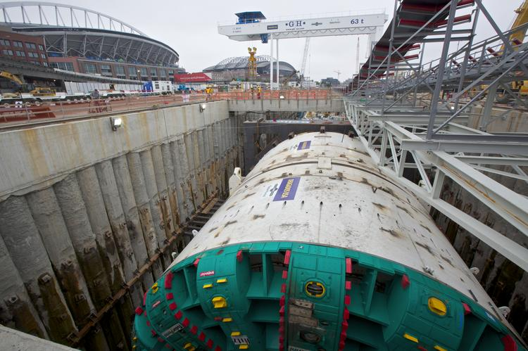 The tunnel boring machine is pictured before Bertha's Pre-Bore Dedication Event in Seattle on July 20, 2013. A state panel said Thursday the project can still be completed on budget, with only a short delay—if the stuck machine can become unstuck on schedule.