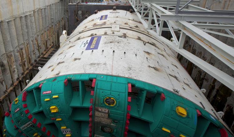 "BERTHA-- A thing called Bertha is one of 2013's most compelling stories. The world's largest tunneling machine arrived in Seattle from Japan in April and began burrowing a 1.7-mile highway tunnel under downtown in July. When completed, the double-decker tube will replace the earthquake-damaged Alaskan Way Viaduct. Bertha's 57.5-foot-diameter cutter head can swallow 3-foot boulders, but it can't chew through everything. A labor dispute shut down the project for about a month this summer, and tunneling stopped again Dec. 6 when Bertha encountered what machine operators said was a possible obstruction. The original plan was to complete tunneling late next year and open the $2.05 billion tunnel to traffic a year later. But a week after the latest stoppage, project spokeswoman KaDeena Yerkan said, ""It is too early to know how this will impact the cost and schedule."""