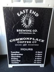 A sandwich board shares hours of operation.
