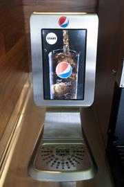 A new soda dispenser is shown at the new KFC eleven store.