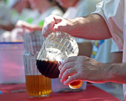 Volunteers pour tasters and full glasses of the 80+ beers at the Oregon Brewers Festival.