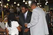 Jacksonville Mayor Alvin Brown shook hands with visitors prior to President Obama's speech.