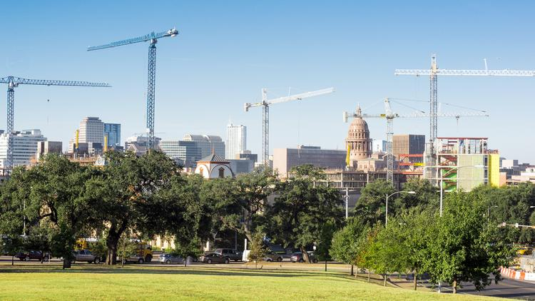 Leaders at Dell Medical School, pictured rising among the Austin skyline, have emphasized the part it will play in turning research into real-world applications and business opportunities through programs such as the Texas Health Catalyst program.