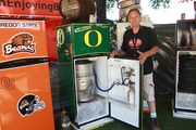 The Oregon Brewers Festival has lots of vendors. Greg Neurohr, president of Keg Gator, shows off his beer lovers line.