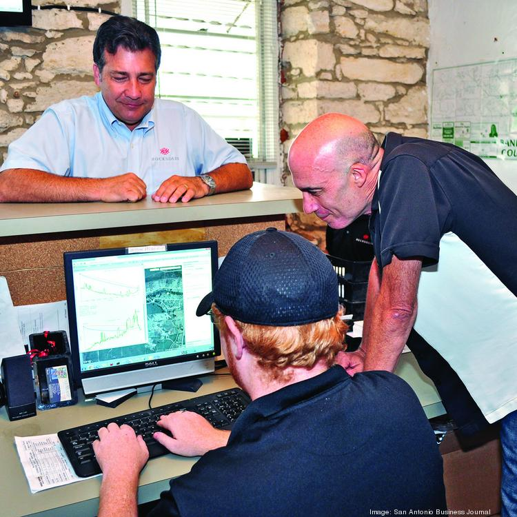 Shane Mitchell (top) looks on as VP Mark Manning (far right) examines the rural territory served by Rock Solid Internet & Telephone.