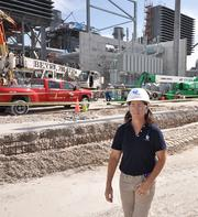 Kelly Fagan, production manager at FPL's new Riviera Beach facility, walks the grounds of the model for its new Fort Lauderdale plant.