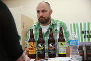 Jay Gilbert, owner of Burnside Brewery,  visits with Green Zebra employees during a vendor fair this week. Green Zebra opens its first store Sept. 25 in Kenton.