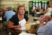 Lisa Sedlar, CEO and Founder of Green Zebra Grocery, listens as Jeremy Karp pitches his sustainably-made chocolates during a vendor fair this week. Green Zebra opens its first store Sept. 25 at 3011 N. Lombard in Kenton.