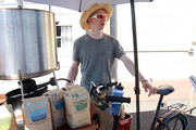 Charlie Wicker, owner of Trailhead Coffee Roasters, pedaled his bike-mounted coffee cart to Green Zebra Grocery's future store on Southeast Division Street for a vendor fair. Wicker hoped the green-minded Trailhead brand would be a good fit for Green Zebra.