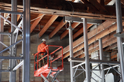 A worker from R&H Construction works on repairing and upgrading trusses at the future Green Zebra Grocery, 3011 N. Lombard St.