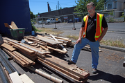 Dennis Cleaver, superintendent of R&H Construction, will recycle Doug Fir salvaged from the old Super Buffet into planters, benches, tables and more for Green Zebra Grocery.