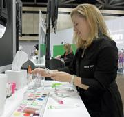 Mary Kay representative Jennifer Juric sets up a play station to teach consultants about the new line of cosmetics.