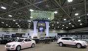Cars that representatives can earn through sales are displayed at the Mary Kay expo.