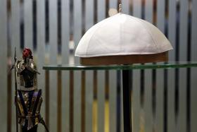 A white papal skull cap sits on display in the window of Gammarelli, an ecclesiastical tailors store in Rome. Gammarelli was founded in 1797 under Pope Pius VI as tailors to the clergy.
