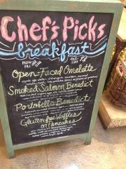 A chalkboard lists the daily specials