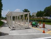 Sections of the Gary Sain Memorial Bridge sit next to the work site between the Orange County Convention Center West Wing and the Rosen Plaza Hotel.