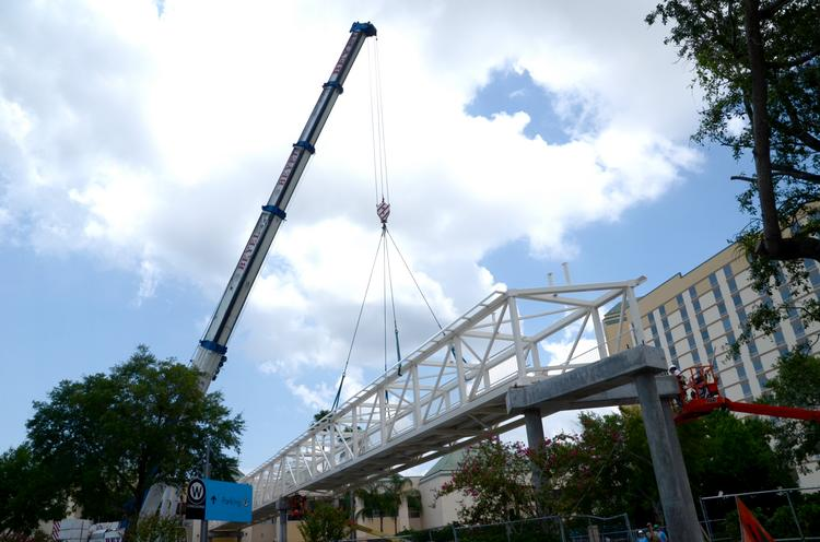 Work progresses on the Gary Sain Memorial Bridge linking the Orange County Convention Center West Wing to the Rosen Plaza Hotel.