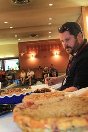 Bob Evans Senior Development Chef Brian Wilson judges crumb pie at the fair. He said he is on the lookout for a great pie for his kitchen.