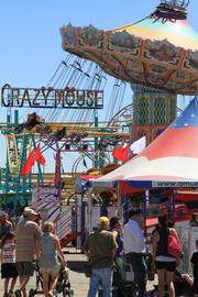Rides dominate the Midway at the fair.