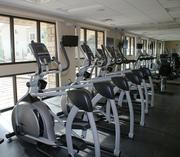The exercise room is at the clubhouse, facing the pool.