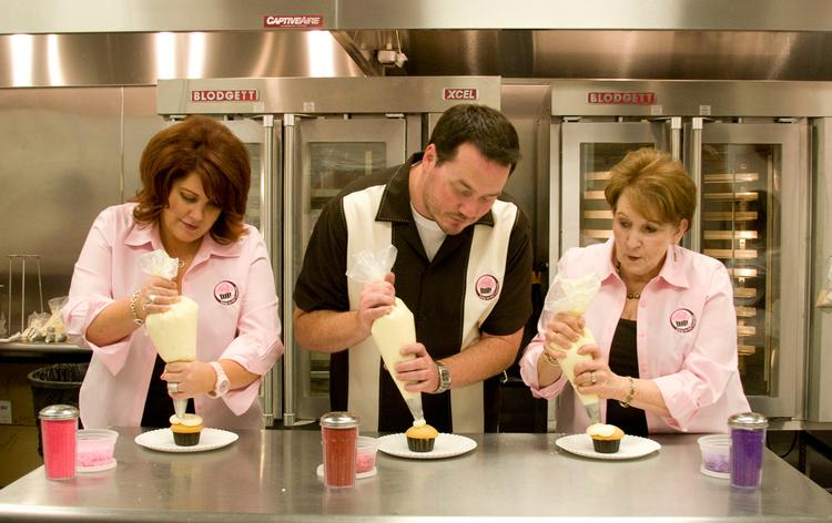 Icing on the Cupcake owners Christee Owens, Chuck Meridith and Shirley Nagasawa put the finishing touches on cupcakes. It's been almost a week since the owners of Icing on the Cupcake, which started with a tiny Rocklin store in 2007, posted a Facebook message saying they're closing due to economic hardship. But the cupcake chain's bankruptcy attorney says there's still discussion of trying to stay open.