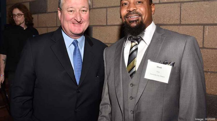 Mayor elect Jim Kenney and Mark Gay, University City District (UCD). Gay University City District (UCD) graduated from the West Philadelphia Skills Initiative (WPSI) program and now works with UCD in the landscaping department.