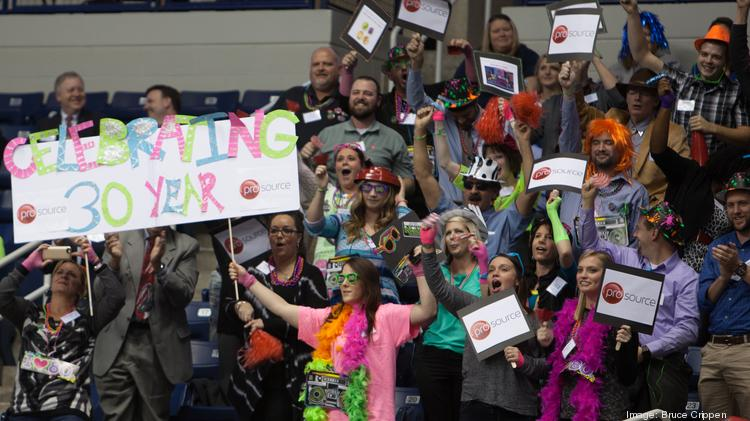 The crowd cheers during the pep rally at the Courier's Best Places to Work event at Cintas Center on Thursday.