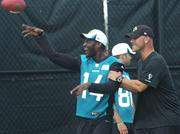 Jacksonville Jaguars head coach Gus Bradley shares a laugh with wide receiver Justin Blackmon during training camp. Although Blackmon was on the field, he did not participate, as his on the physically unable to perform list.