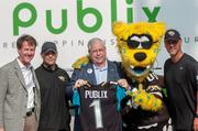 From left: Jaguars Senior Vice President of Corporate Partnerships Scott Massey, General Manager David Caldwell, Publix Jacksonville Division Vice President Scott Brubeck, Jaxson DeVille and head coach Gus Bradley welcome Publix as the team's official supermarket during a Saturday morning press conference at EverBank Field.