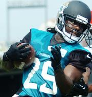 Jaguars rookie offensive weapon Denard Robinson participates drills during training camp Saturday morning.