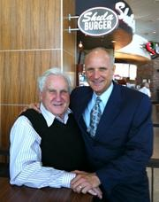 NFL Hall of Fame Coach Don Shula, left, and his eldest son, Dave (right), have signed local franchisee Kevin Gowen Sr. to bring the Shula Burger concept to Central Florida.
