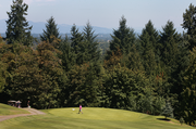 A golfer walks off a green at the Wildwood Golf Course during the recent Brody Borlaug Memorial Golf Tournament, which raises funds for Doernbecher Children's Hospital at OHSU.