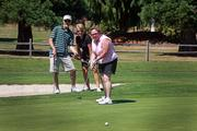 Debbie Kitchin of InterWorks LLC puts during the annual Building Owners and Managers Association's annual golf tournament, held earlier this month at The Reserve  Vineyards and Golf Club in Aloha.